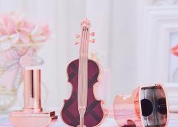 violin lipstick tube with purple cap